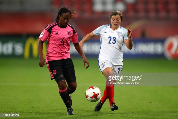 Ifeoma Dieke of Scotland looks to break away from Fran Kirby of England during the UEFA Women's Euro 2017 Group D match between England and Scotland...