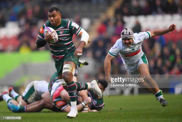 Ifereimi Boladau of Leicester Tigers breaks from Lucas Rey of Pau during the European Rugby Challenge Cup Round 1 match between Leicester Tigers and...
