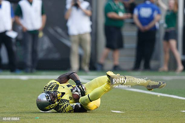 Ifo EkpreOlomu of the Oregon Ducks intercepts a pass in the fourth quarter of the game against the Michigan State Spartans at Autzen Stadium on...