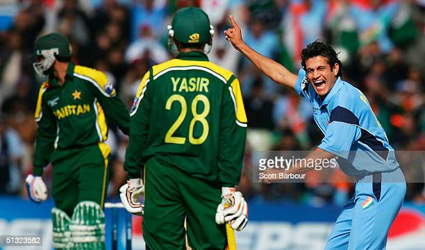 Ifran Pathan of India celebrates after dismissing Shoaib Malik of Pakistan as Yasir Hameed looks on during the ICC Champions Trophy match between...