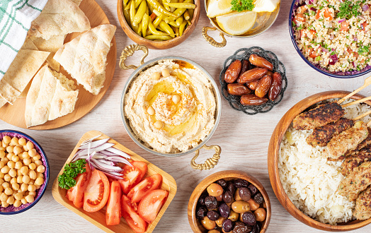 Iftar food table. Evening meal for Ramadan. Arabic cuisine. Middle Eastern traditional lunch. Assorted of Egyptian oriental dishes. Top view 1136180458