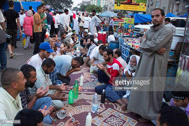 Iftar - the evening meal muslims have to break their fast during Ramadan - at the Muslim Brotherhood sit-in at the Rabaa Al Adaweyya mosque in the...