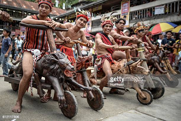 Ifugao tribesmen ride wooden scooters during the Imbayah festival in Banaue town Ifugao province northern Philippines April 27 2014 The Imbayah...