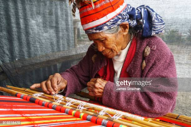 Ifugao (ancient culture of wet-rice agriculturalists) woman weaver in traditional dress and hat, Banaue, Luzon Island, Philippines (Model Release)