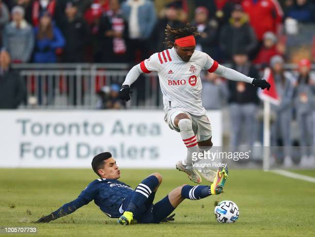 Ifunanyanchi Achara of Toronto FC dribbles the ball as Ronald Matarrita of New York City FC defends during the first half of an MLS game at BMO Field...