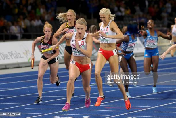 Iga BaumgartWitan and Patrycja Wyciszkiewicz of Poland exchange the baton in the Women's 4 x 400m Relay Final during day five of the 24th European...