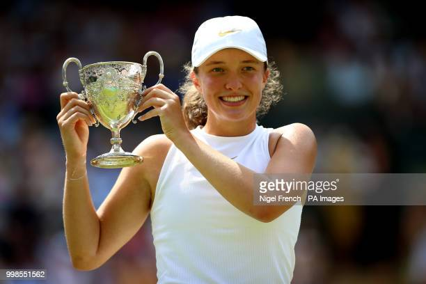 Iga Swiatek celebrates winning the girls singles final against Leonie Kung on day twelve of the Wimbledon Championships at the All England Lawn...