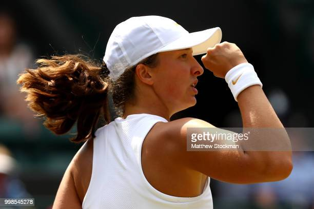 Iga Swiatek of Poland celebrates a point against Leonie Kung of Switzerland during the Girls' Sinngles final on day twelve of the Wimbledon Lawn...