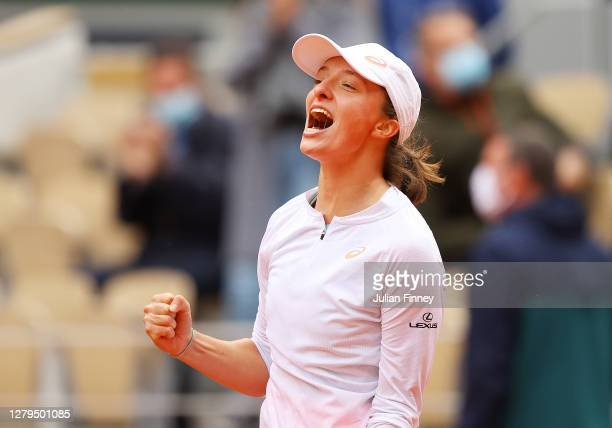Iga Swiatek of Poland celebrates after winning championship point during her Women's Singles Final against Sofia Kenin of The United States of...