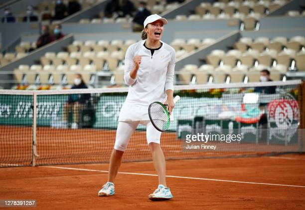 Iga Swiatek of Poland celebrates after winning match point during her Women's Singles fourth round match against Simona Halep of Romania on day eight...