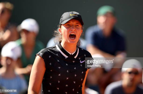 Iga Swiatek of Poland celebrates during her ladies singles third round match against Monica Puig of Peru during Day seven of the 2019 French Open at...