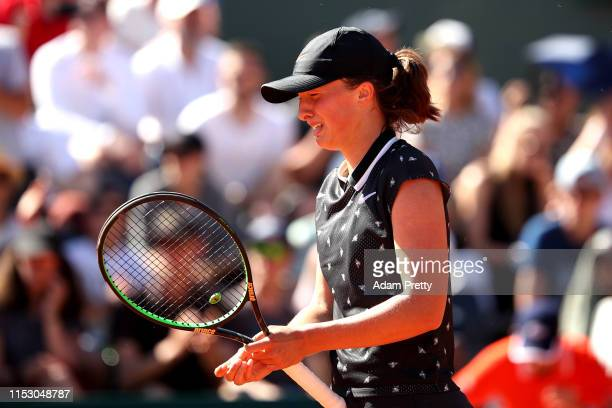 Iga Swiatek of Poland celebrates victory during her ladies singles third round match against Monica Puig of Peru during Day seven of the 2019 French...