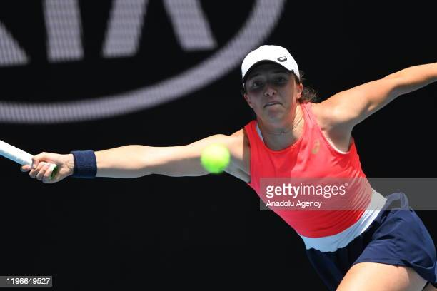 Iga Swiatek of Poland in action against Anett Kontaveit of Estonia during women's singles match within 2020 Australian Open at Melbourne Park in...