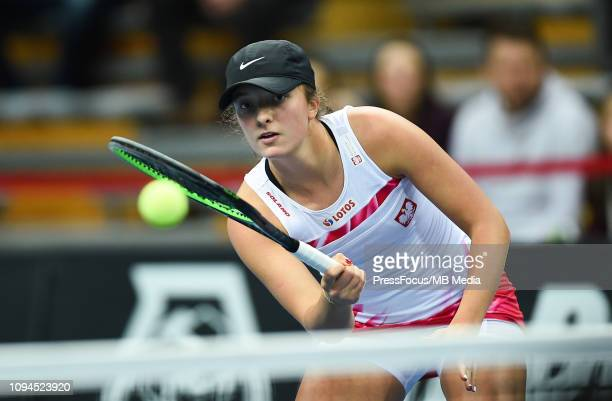 Iga Swiatek of Poland in action during her doubles match against Margarita Gasparian and Daria Kasatkina of Russia during the Fed Cup Europe and...