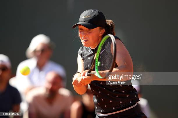 Iga Swiatek of Poland plays a backhand during her ladies singles third round match against Monica Puig of Peru during Day seven of the 2019 French...