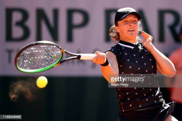 Iga Swiatek of Poland plays a forehand during her ladies singles third round match against Monica Puig of Peru during Day seven of the 2019 French...