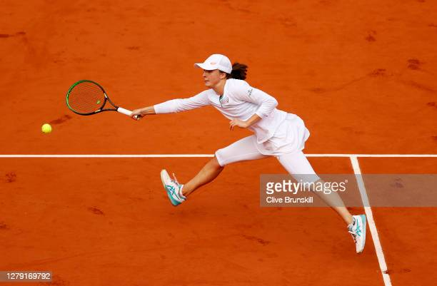 Iga Swiatek of Poland plays a forehand during her Women's Singles semifinals match against Nadia Podoroska of Argentina on day twelve of the 2020...