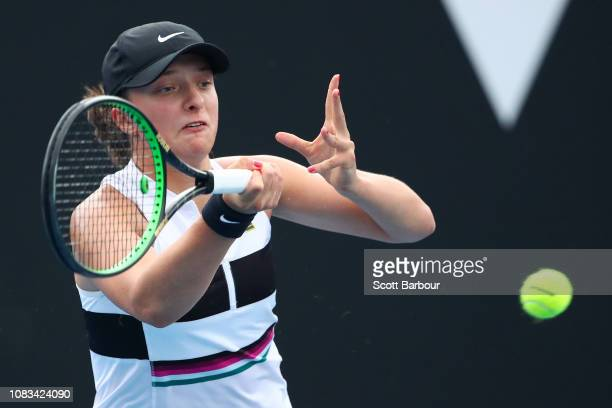 Iga Swiatek of Poland plays a forehand in her second round match against Camila Giorgi of Italy during day four of the 2019 Australian Open at...