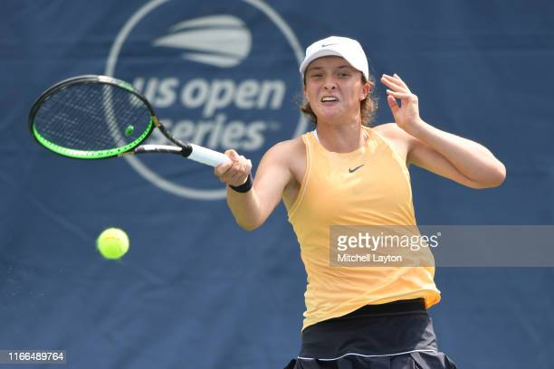 Iga Swiatek of Poland returns a shot from Jessica Pegula of the United States during Day 3 of the Citi Open at Rock Creek Tennis Center on July 31...