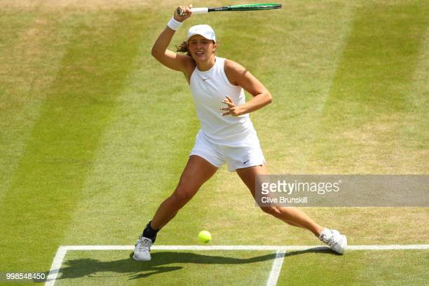 Iga Swiatek of Poland returns against Leonie Kung of Switzerland during the Girls' Singles final on day twelve of the Wimbledon Lawn Tennis...