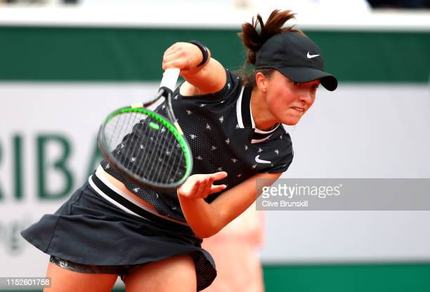 Iga Swiatek of Poland serves during her ladies singles second round match against Qiang Wang of China during Day five of the 2019 French Open at...