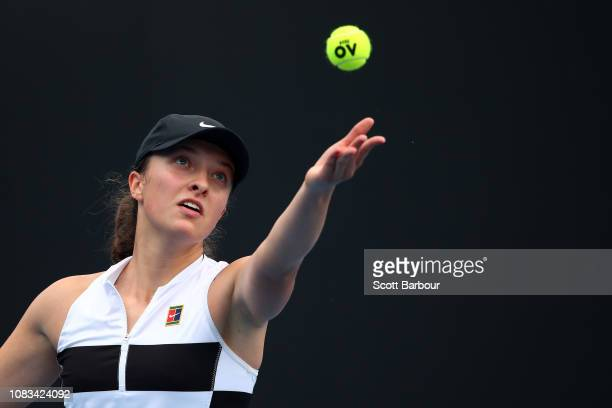 Iga Swiatek of Poland serves in her second round match against Camila Giorgi of Italy during day four of the 2019 Australian Open at Melbourne Park...