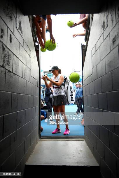 Iga Swiatek of Poland signs autographs following her second round match against Camila Giorgi of Italy during day four of the 2019 Australian Open at...