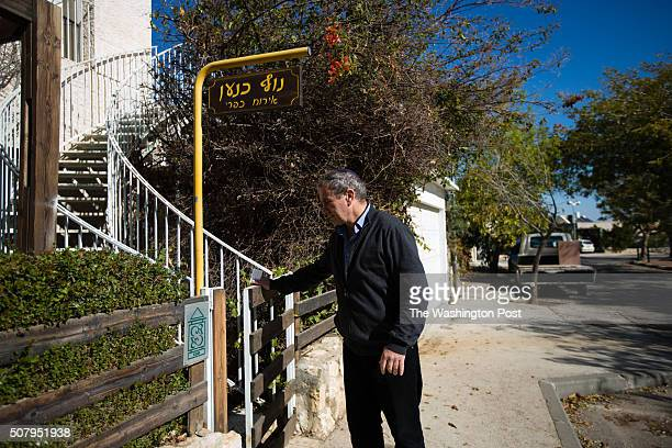 Igal Canaan opens the gate to his bed and breakfast 'Nof Canaan' which is advertised on Airbnb international homesharing site and rental listings...