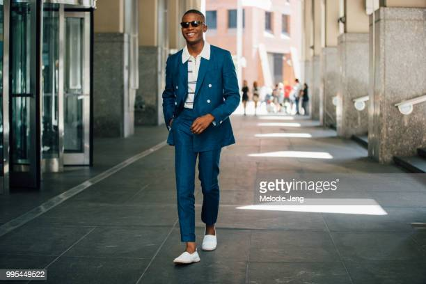 1c3242018 Igee Okafor wears a Sandro Homme blue suit and Institchu shirt during New  York Fashion Week