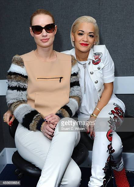 Iggy Azalea and Rita Ora attend KISS FM's Studio's to chat with Melvin O'Doom and Ricky Haywood Williams on September 18 2014 in London England Rita...