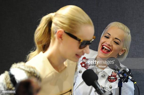 Iggy Azalea and Rita Ora chat with KISS FM's Melvin O'Doom and Ricky Haywood Williams at Kiss FM Studio's on September 18 2014 in London England Rita...