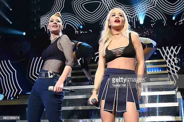 Iggy Azalea and Rita Ora perform Black Widow during Q102's Jingle Ball on December 10 2014 in Philadelphia Pennsylvania