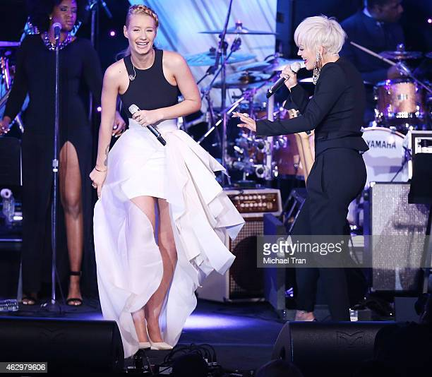Iggy Azalea and Rita Ora perform onstage during The Grammy Awards PreGrammy Gala held at The Beverly Hilton Hotel on February 7 2015 in Beverly Hills...