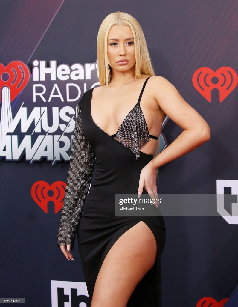 Iggy Azalea arrives to the 2018 iHeartRadio Music Awards held at The Forum on March 11, 2018 in Inglewood, California.