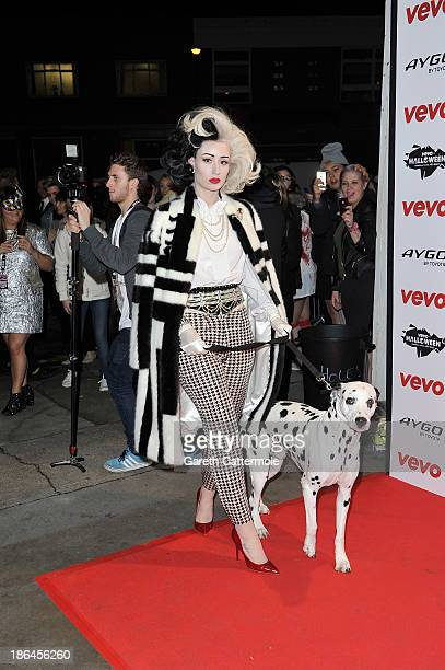 Iggy Azalea dressed as Cruella de Vil attends the VEVO Halloween showcase at The Oval Space on October 31 2013 in London England