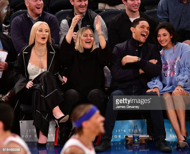 Iggy Azalea guest Trevor Noah and Jordyn Taylor attend the New York Knicks vs Washington Wizards game at Madison Square Garden on February 14 2018 in...