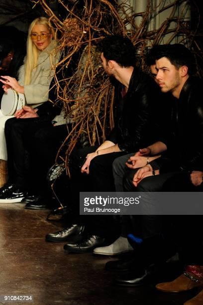 Iggy Azalea Kevin Jonas Joe Jonas and Nick Jonas attend the John Varvatos Fall/Winter 2018 Show Runway at The Angel Orensanz Foundation on January 26...