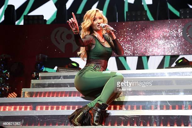 Iggy Azalea performs at the 2014 Hot 99.5 Jingle Ball at Verizon Center on December 15, 2014 in Washington, DC.