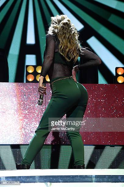 Iggy Azalea performs onstage during HOT 995's Jingle Ball 2014 Presented by Mattress Warehouse at the Verizon Center on December 15 2014 in...