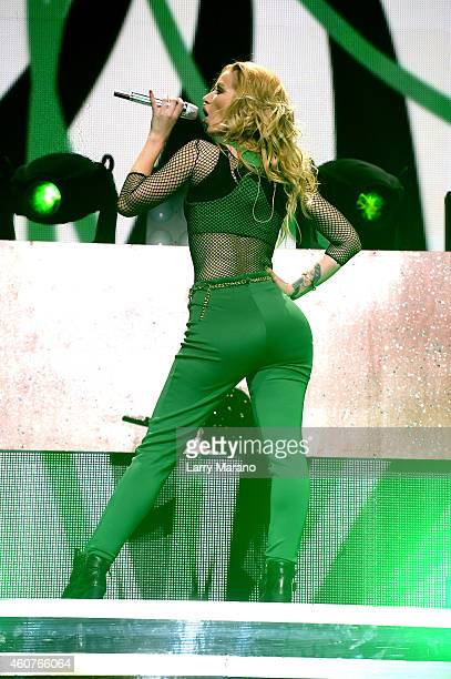 Iggy Azalea performs onstage during Y100's Jingle Ball 2014 at BBT Center on December 21 2014 in Miami FL