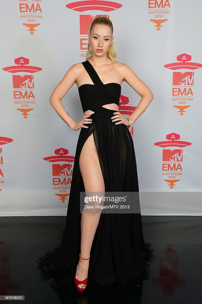 Iggy Azalea poses in the Exclusive Arrivals Studio during MTV EMA's 2013 at the Ziggo Dome on November 10, 2013 in Amsterdam, Netherlands.