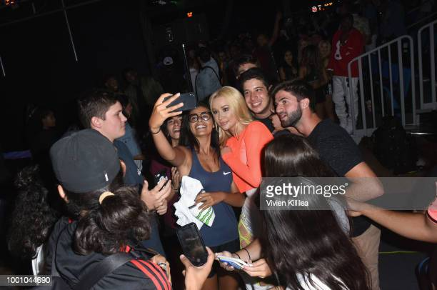 Iggy Azalea poses with fans backstage at 50K Charity Challenge Celebrity Basketball Game at UCLA's Pauley Pavilion on July 17 2018 in Westwood...