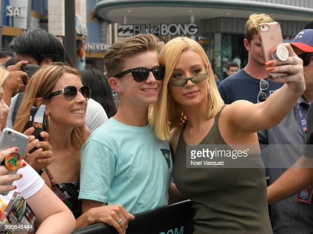 Iggy Azalea takes selfies with fans at 'Extra' at Universal Studios Hollywood on July 10 2018 in Universal City California