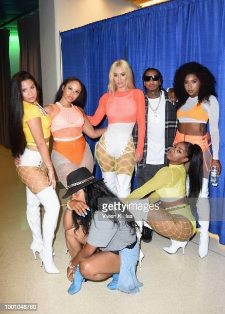 Iggy Azalea Tyga and Oththan Burnside pose with dancers backstage at 50K Charity Challenge Celebrity Basketball Game at UCLA's Pauley Pavilion on...