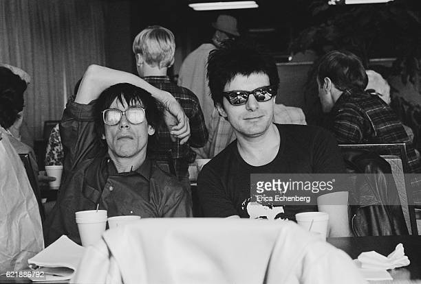 Iggy Pop and Brian James at an airport USA 1982