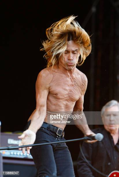 Iggy Pop and The Stooges performs live on the main stage during day two of the Isle of Wight Festival 2011 at Seaclose Park on June 11 2011 in...