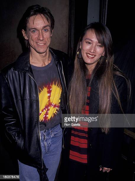 Iggy Pop and wife Suchi Asano attend the premiere party for Cry Baby on April 3 1990 at MK Club in New York City