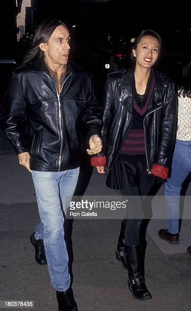 Iggy Pop and wife Suchi Asano attend the screening of Serial Mom on April 4 1994 at Loew's Screening Room in New York City
