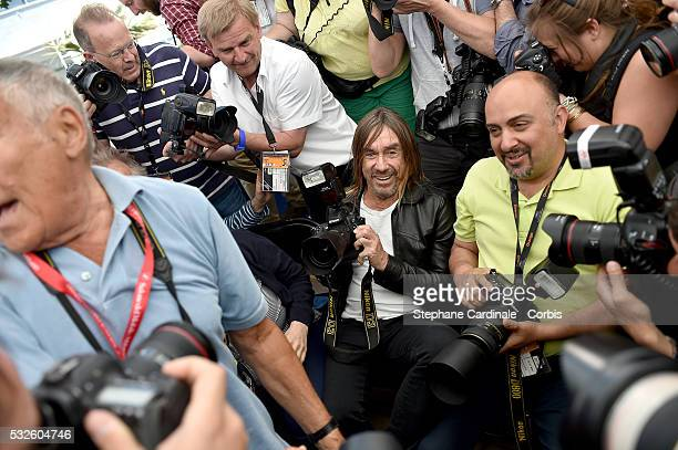 Iggy Pop joins photographers at the 'Gimme Danger' photocall during the 69th annual Cannes Film Festival at Palais des Festivals on May 19 2016 in...