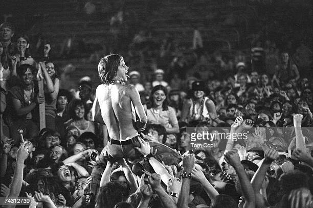 Iggy Pop of the Stooges rides the crowd during a concert at Crosley Field on June 23 1970 in Cincinnati Ohio